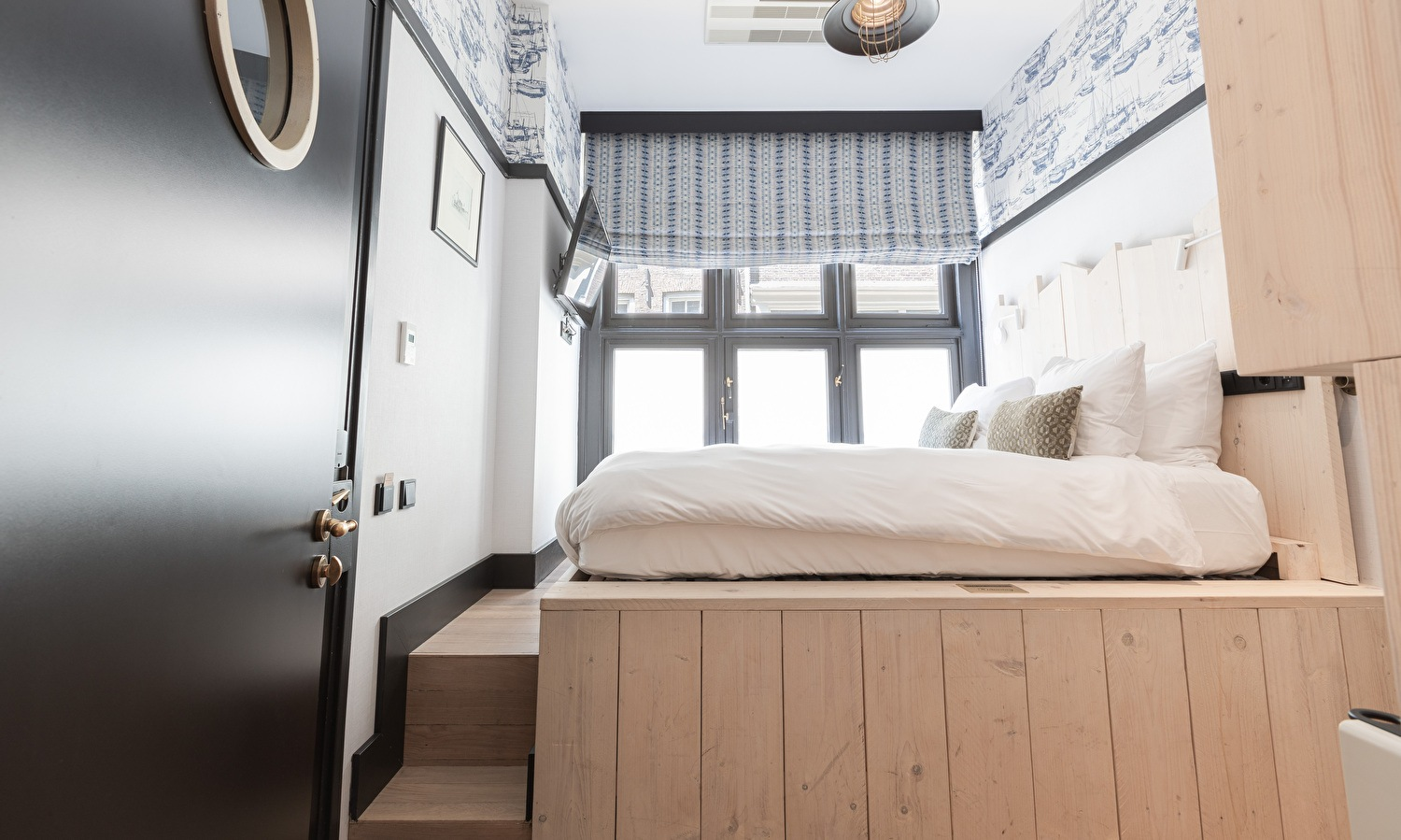 With our unique Hendrick's Hideaway, the bed is on an elevated platform